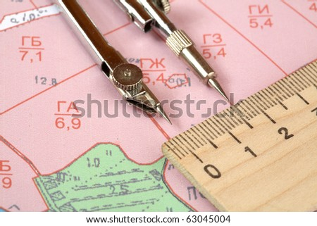 Topographic map of district with  measuring instrument and ruler