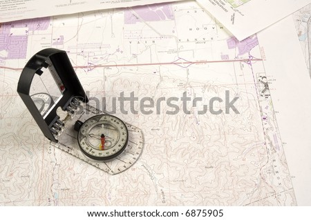 Topographical map and compass - stock photo