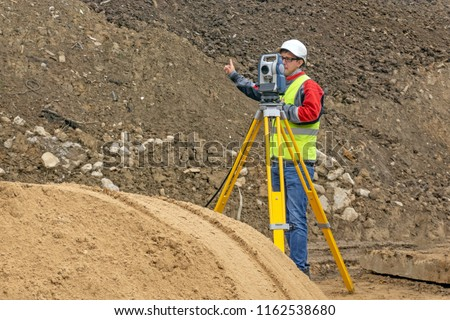 Topographical survey of the terrain by a surveyor