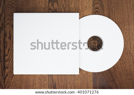 Topview of blank white compact disk with cover on wooden table. Mock up, 3D Rendering