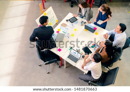 topview of creative agency business brain storm meeting presentation Team discussing roadmap to product launch, presentation, planning, strategy, new business development #1481870663