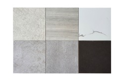topview of multiple type of stone tile samples in square shape contains travertine bone ,white marble ,black marble ,grey concrete ,beige concrete patterns. tile samples isolated on white background.