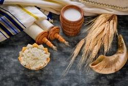 Torah and kippah on celebration traditional Jewish Holiday Shavuot for Kosher dairy product