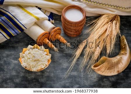 Torah and kippah on celebration traditional Jewish Holiday Shavuot for Kosher dairy product Foto stock ©