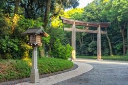Torii gate leading to the Meiji Shrine complex. Meiji Shrine (Meiji Jingu) is a Shinto shrine that is dedicated to the deified spirits of Emperor Meiji and his wife, Empress Shoken, Tokyo, Japan