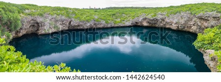 Toriike Pond is a pond located in the western part of Shimojijima Island, Miyakojima, Okinawa, Japan. It looks like two ponds lined up next to each other but they are actually connected underground. #1442624540