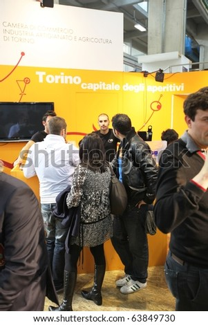 TORINO, ITALY - OCT. 24: People visiting Torino stand at Salone del Gusto, international fair of tastes and slow food on October 24, 2010 in Torino, Italy.