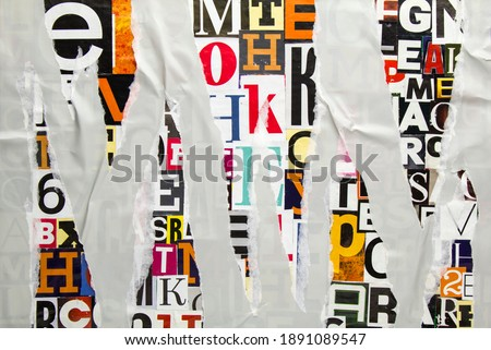 Torn and crumpled grey paper on colorful abstract collage from clippings with newspaper magazine letters and numbers. Ripped gray paper glued on alphabet letters cutting from magazine background. Photo stock ©