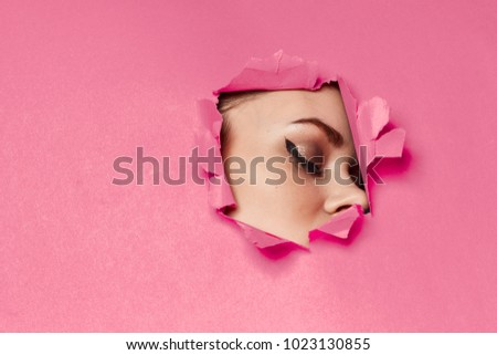 Photo of torn background, woman's eyes, free style