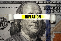 Torn bills revealing Inflation words. Idea for FED consider interest rate hike, world economics and inflation control, US dollar inflation