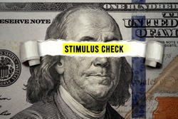 Torn bills revealing Stimulus Check words. Idea for USA check, Coronavirus affects US dollar, people need to spend