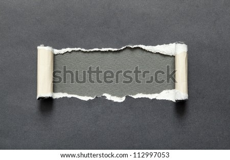 Torn black paper with grey space for your message