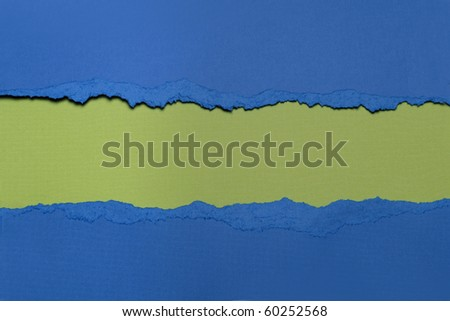 Torn blue Paper with circlet's shape and green  background with space for text