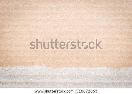 Torn Brown color cardboard paper detail texture patterned background: Cardboard textured pattern detailed backdrop in brown cream colour tone with torn edge