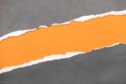 Torn edge paper with orange copyspace for your message