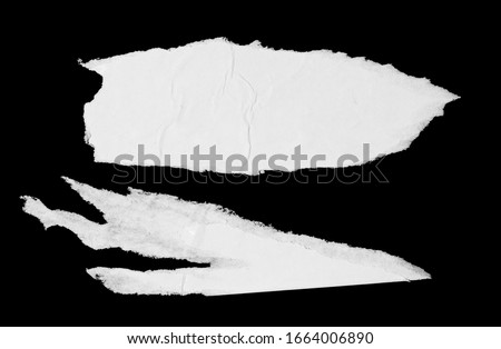 Torn glued paper texture. White ripped wrinkled paper poster pieces isolated on black background