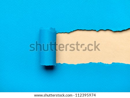 Torn light blue paper with milky copyspace for your message. Paper roll