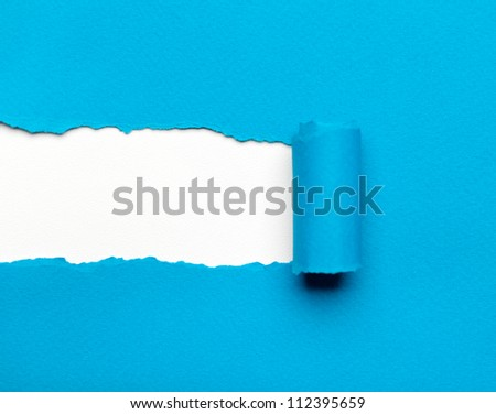 Torn light blue paper with white copyspace for your message. Paper roll - stock photo