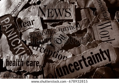 Torn newspaper headlines depicting current events #678932815