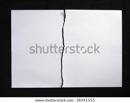 torn or tearing paper into two pieces