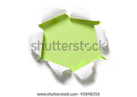 Torn Paper Circle on Green. Focus on curled edges of paper