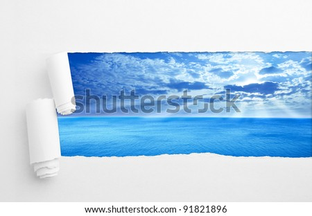 Torn paper on sea background