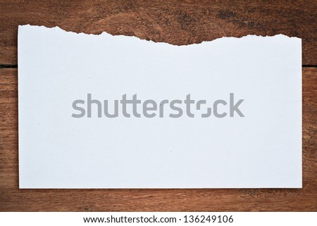 Torn paper on wood background