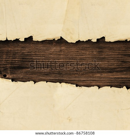 torn paper over the wooden background
