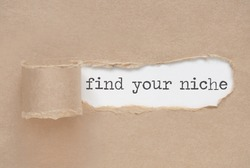 Torn paper revealing the words find your niche