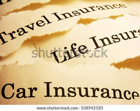 Torn paper with different types of insurance. Insurance concept.