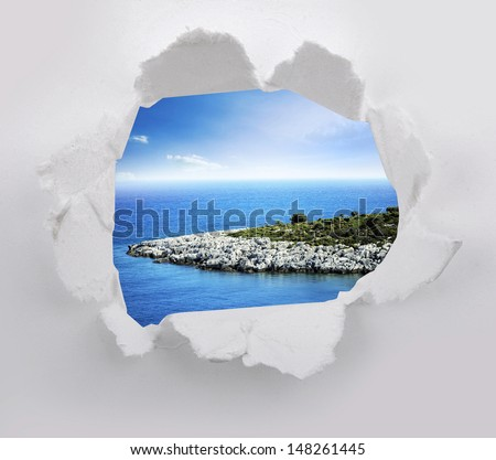 Torn paper with landscape sea sky in opening background