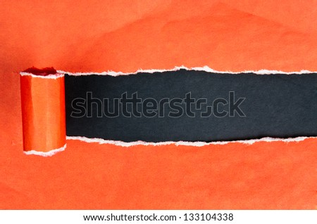 Torn paper with opening showing black background