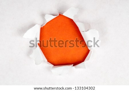 Torn paper with orange space