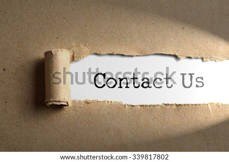 Torn paper with word Contact Us