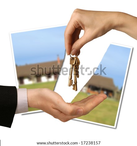 torn photograph of a house behind hands passing keys