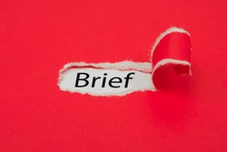 Torn red paper revealing the word Brief. Business concept.