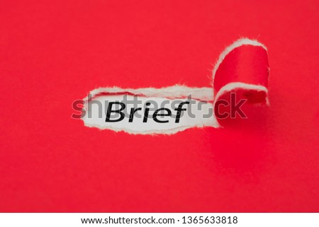 Torn red paper revealing the word Brief. Business concept. Stockfoto ©