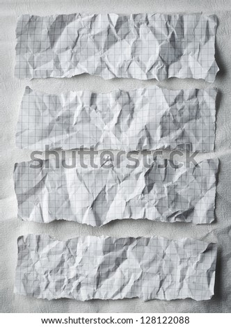 Torn, ripped pieces of math paper on white paper background