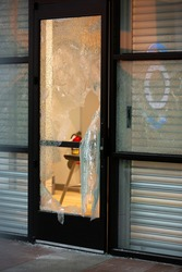 Torn safety glass after a store robbery