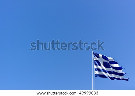 torn weathered and national flag of greece.