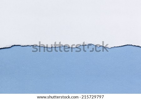 Torn white paper over blue background.