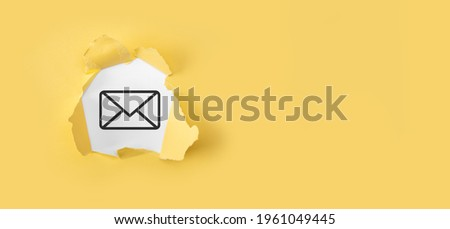 Torn yellow paper with letter email icon on white background.Email marketing and newsletter concept. Contact us by newsletter email and protect your personal information from spam mail concept.