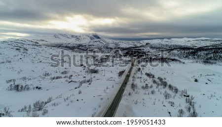 Tornetrask, aerial, rising, drone shot, towards a arctic lake, near Abisko, on a partly sunny day, in Lappland, Norrbotten, Sweden Stock foto ©