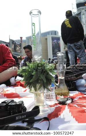 TORONTO - APRIL 20:   Bongs surrounded by marijuana  activists during the annual marijuana 420 event at Yonge & Dundas Square  on April 20  2012 in Toronto, Canada.