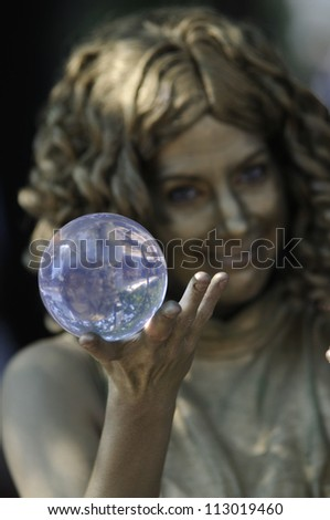 TORONTO-AUGUST 25: A performer juggling with a crystal ball during the Buskerfest Festival on August 25, 2012 in Toronto, Canada.