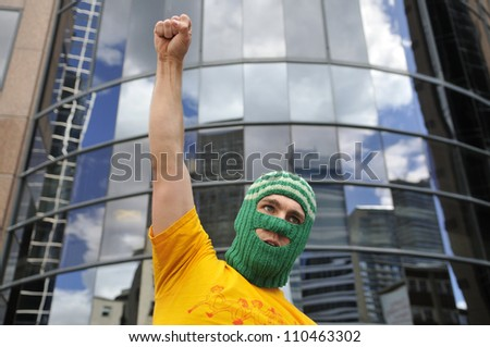 """TORONTO -AUGUST  17:  An angry protester underneath the building that holds the Russian Consulate during a protest rally organized to free """"pussy riot""""on August 17 2012 in Toronto, Canada."""