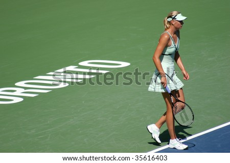 TORONTO - AUGUST 19: Maria Sharapova, Russia, plays at the Rogers Cup vs. Sybille Bammer, Austria, on August 19, 2009 in Toronto