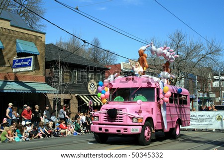 TORONTO, CANADA - APRIL 4: Decorated pink car takes part in an annual Easter Parade 2010 April 4, 2010 in Toronto, Canada. - stock photo