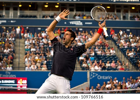 TORONTO, CANADA - AUG 8:  Novak Djokovic  celebrates in style after a long rally against Bernard Tomic at The Rogers Cup ATP Tour Masters 1000 event in Toronto, Canada on Wednesday August 8th, 2012.
