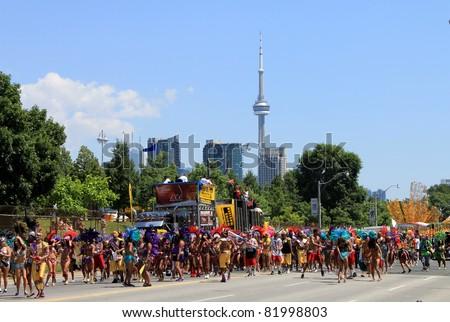 TORONTO, CANADA – JULY 30: Participants take part at annual Caribana Parade in July 30, 2011 in Toronto. Caribana Parade 2011 celebrates its 44 anniversary.
